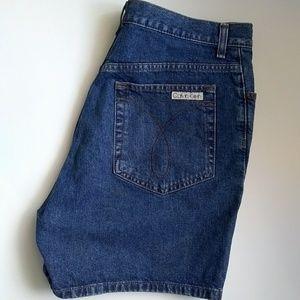 Calvin Klein mid rise medium wash jean shorts 12